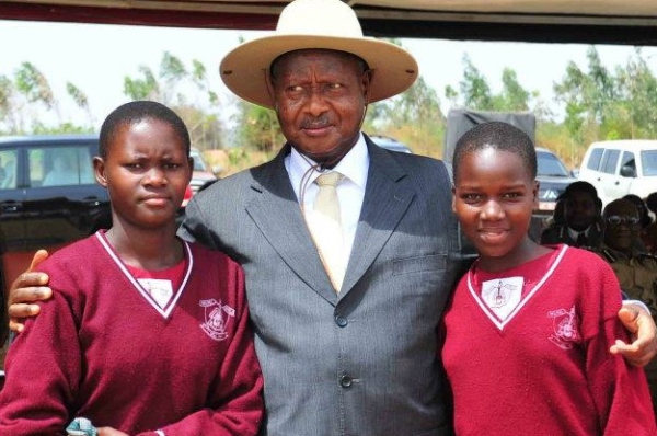 Museveni poses with Nebbi district PLE best performers for 2012 Phoebe ...